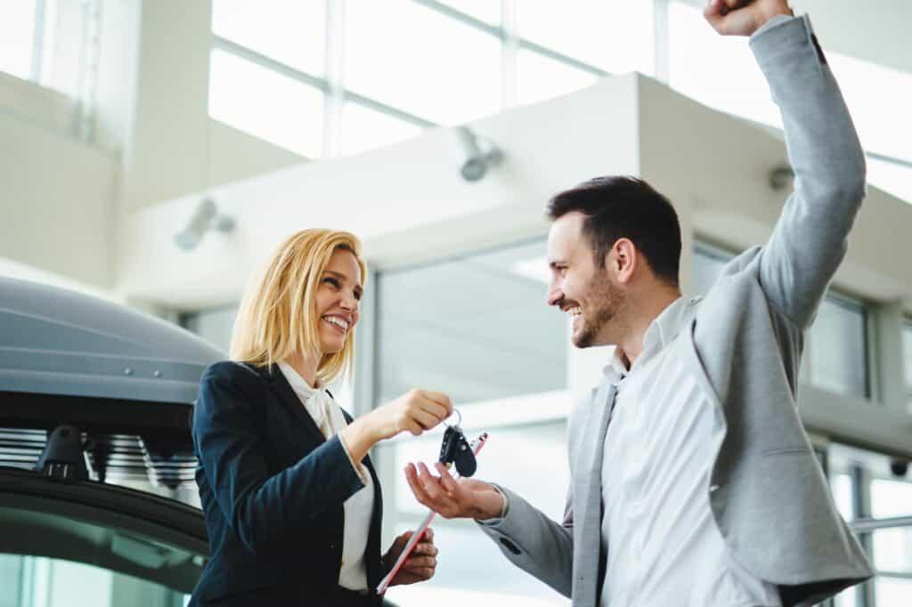 portrait of happy customer buying car